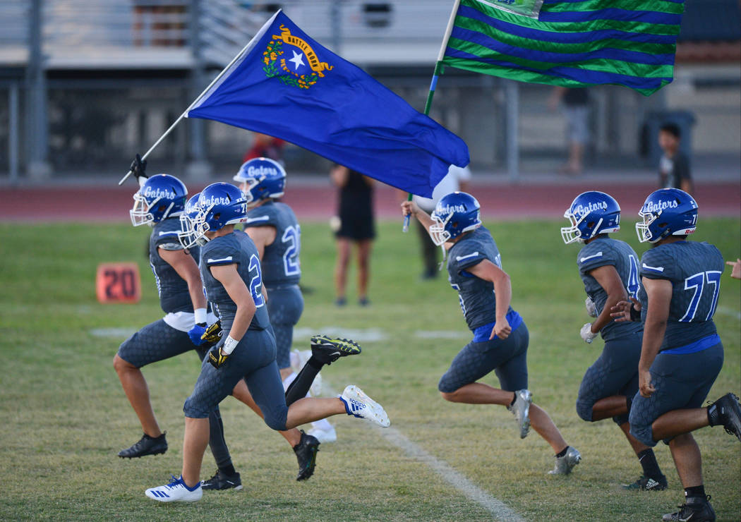 The Green Valley football team takes the field before a game against Sierra Vista at Green Valley High School in Henderson on Friday, Aug. 31, 2018. Green Valley won 26-21. Brett Le Blanc Las Vega ...