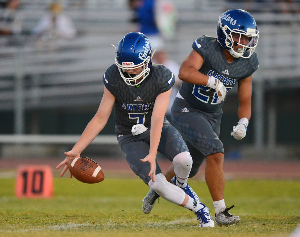A bad snap causes a fumble as Green Valley quarterback Garrett Castro (7) tries to recover the ball at Green Valley High School in Henderson on Friday, Aug. 31, 2018. Green Valley won 26-21. Brett ...