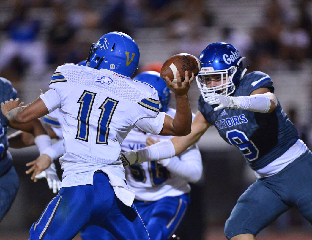 Green Valley defender Mitch Jacobs (9) chases down Sierra Vista quarterback Jordon Solomon (11) during a game at Green Valley High School in Henderson on Friday, Aug. 31, 2018. Green Valley won 26 ...
