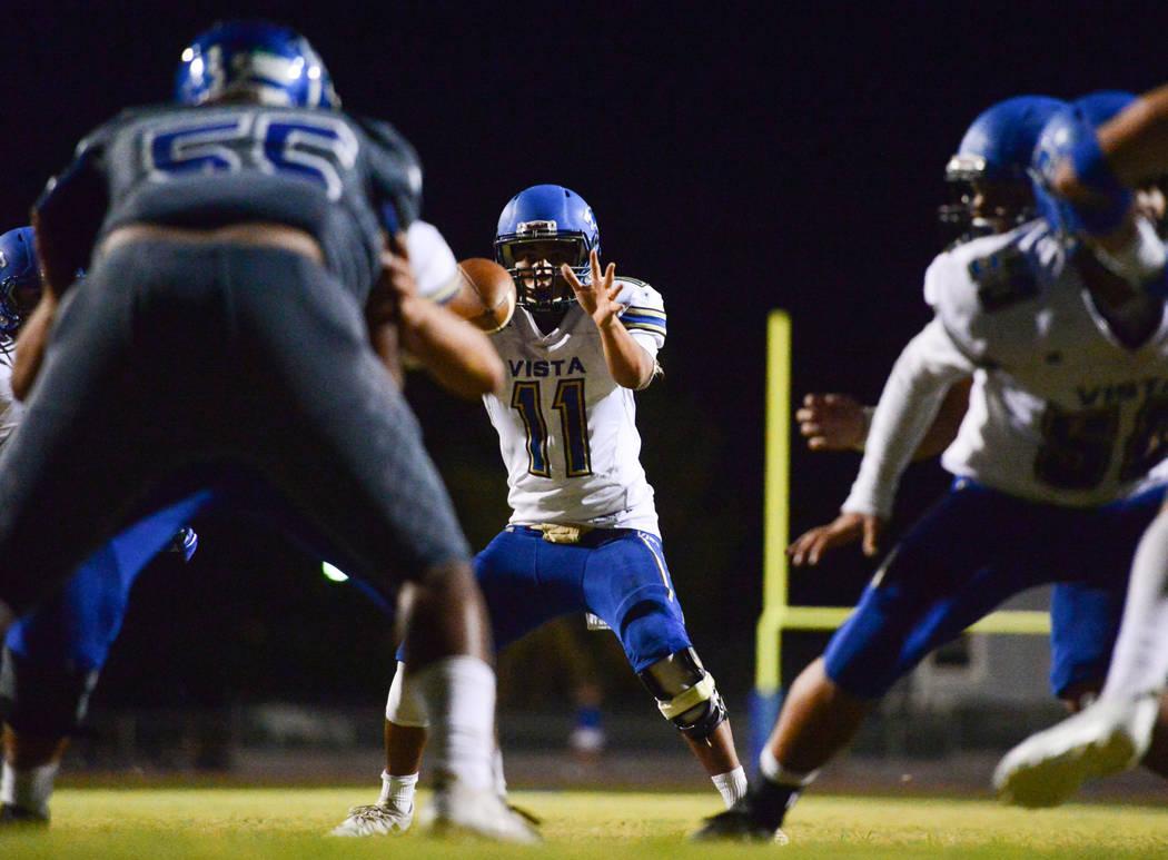 Sierra Vista quarterback Jordan Solomon (11) takes a snap during a game against Green Valley at Green Valley High School in Henderson on Friday, Aug. 31, 2018. Green Valley won 26-21. Brett Le Bla ...