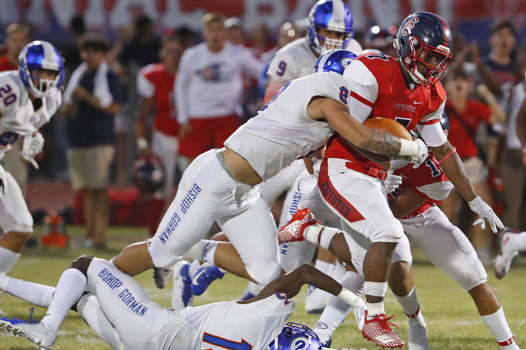Bishop Gorman's Treven Ma'ae (8) tackles Centennial's Tawee Walker (7) during a game at Centennial High School in Peoria, Ariz. on Aug. 31, 2018. Patrick Breen The Arizona Republic