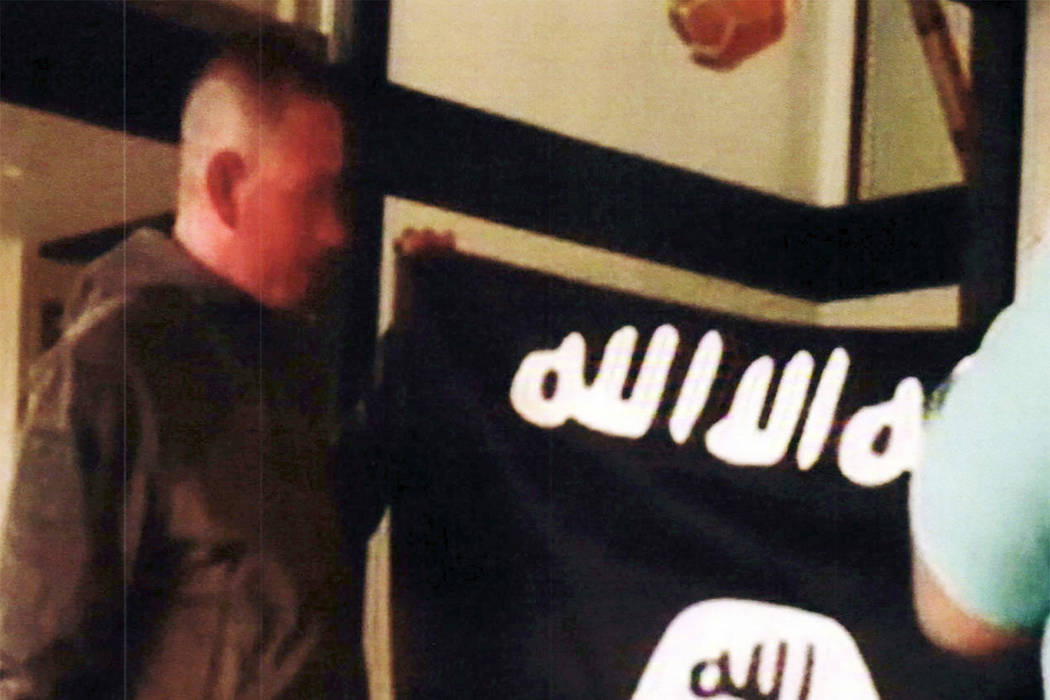 In this July 8, 2017 file image taken from FBI video and provided by the U.S. Attorney's Office in Hawaii on July 13, 2017, Army Sgt. 1st Class Ikaika Kang holds an Islamic State group flag after ...
