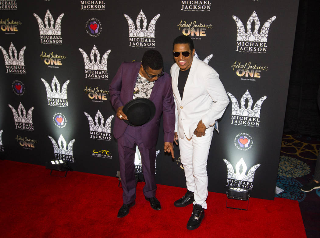Tito Jackson, left, points at Jackie Jackson's shoes on the red carpet ahead of the Michael Jackson 60th birthday celebration at Manalay Bay in Las Vegas on Wednesday, Aug. 29, 2018. Chase Stevens ...
