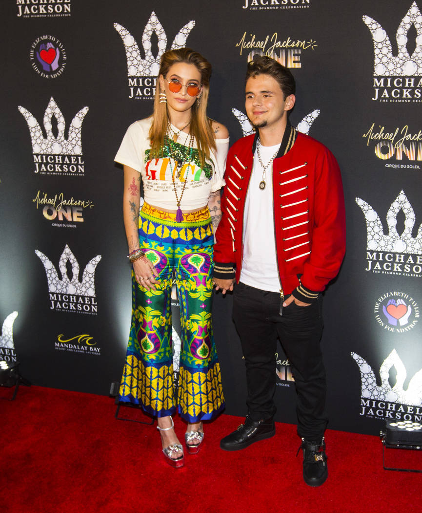 Paris Jackson, left, and Prince Jackson, children of Michael Jackson, pose on the red carpet ahead of the Michael Jackson 60th birthday celebration at Manalay Bay in Las Vegas on Wednesday, Aug. 2 ...