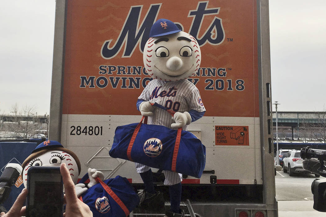 New York Mets mascot Mr. Met poses on the loading ramp of the team's equipment truck at Citi Field, Thursday, Feb. 1, 2018, in New York, as the truck was packed to leave for spring training ...