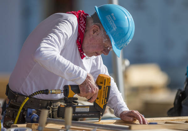 Former President Jimmy Carter works with other volunteers on site during the first day of the weeklong Jimmy & Rosalynn Carter Work Project, their 35th work project with Habitat for Humanity, ...