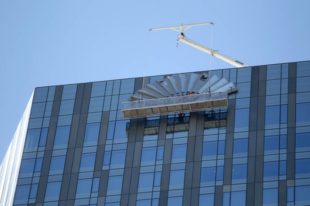 Crews work to remove a sign for Mandarin Oriental on the Las Vegas Strip. Hilton Hotels started to rebrand the property as Waldorf Astoria on Friday, August 31, 2018. (K.M. Cannon Las Vegas Review ...
