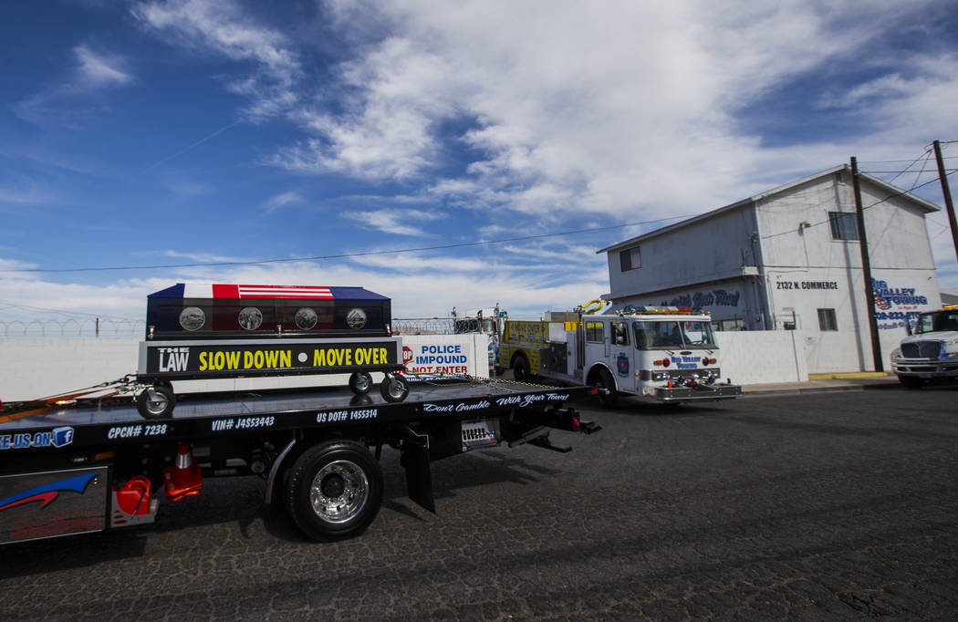 The ceremonial casket is transported as part of the Spirit Ride procession at Big Valley Towing in North Las Vegas on Thursday, Aug. 30, 2018. The cross-country event, which promotes move over law ...