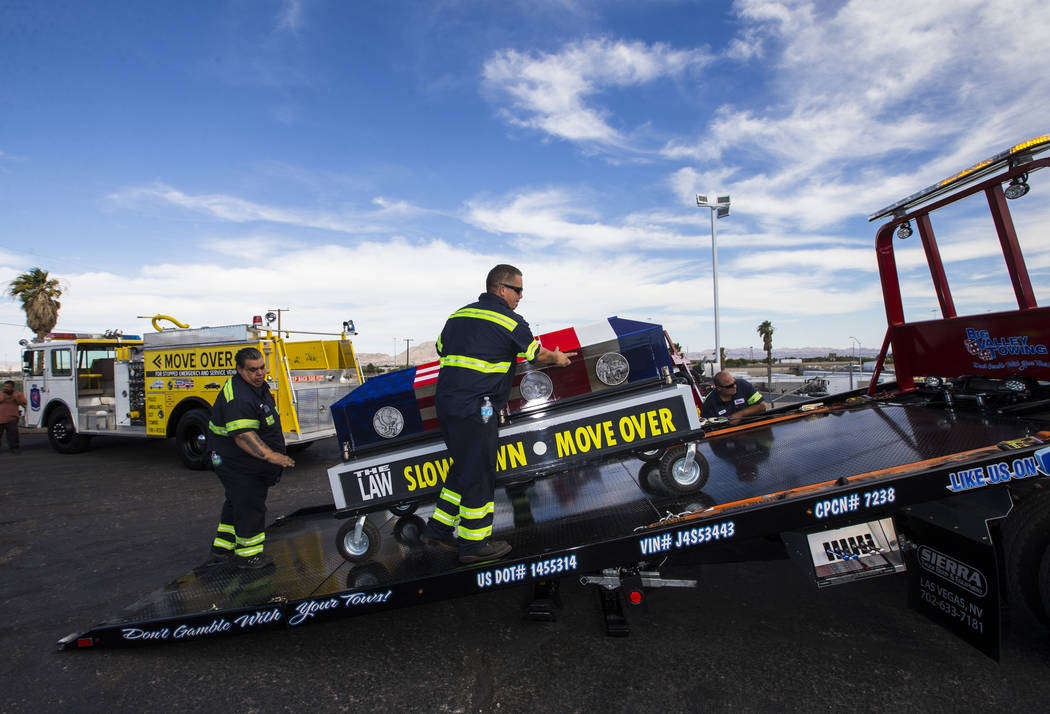 Andres Werne of Big Valley Towing, center, helps move the ceremonial casket after the Spirit Ride ceremony at Big Valley Towing in North Las Vegas on Thursday, Aug. 30, 2018. The cross-country eve ...