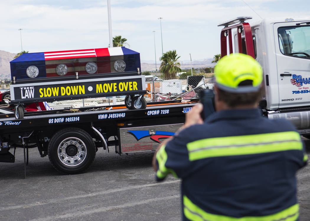 Gary Drake of Big Valley Towing records the ceremonial casket before the start of the Spirit Ride ceremony at Big Valley Towing in North Las Vegas on Thursday, Aug. 30, 2018. The cross-country eve ...