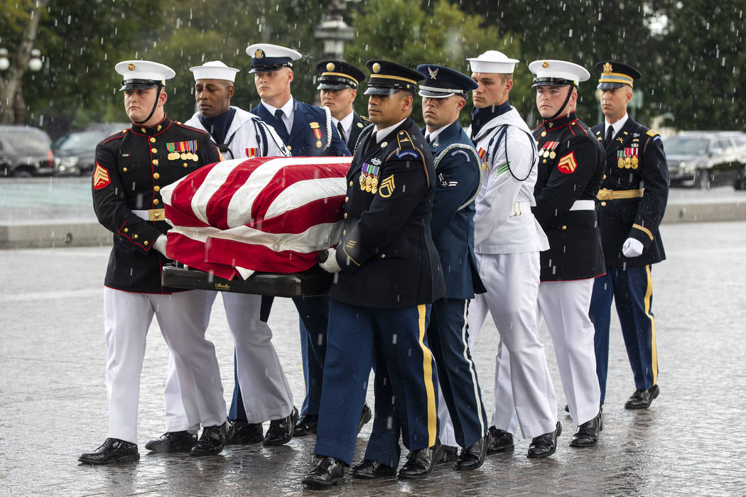 The flag-draped casket of Sen. John McCain, R-Ariz., is carried by joint service members into the U.S. Capitol, Friday, August 31, 2018 in Washington. (Jim Lo Scalzo/Pool photo via AP)