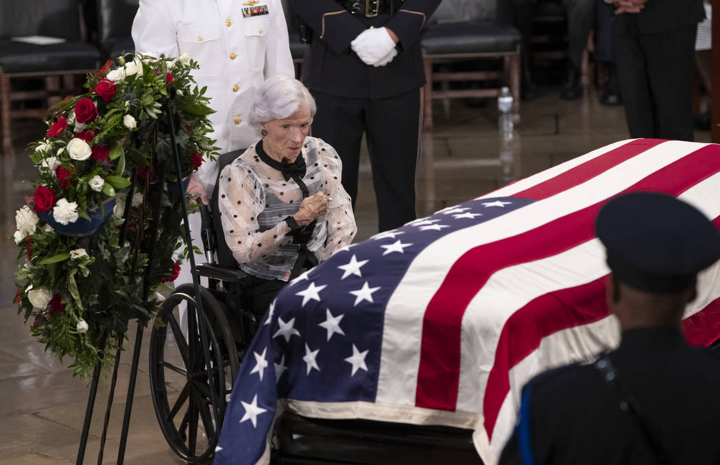 Roberta McCain, the 106-year-old mother of Sen. John McCain of Arizona, stops at his flag-draped casket in the U.S. Capitol rotunda during a farewell ceremony, Friday, Aug. 31, 2018, in Washington ...