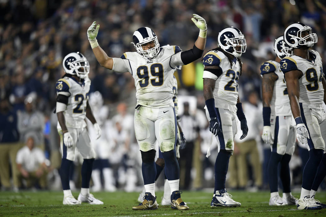 f52761296 Los Angeles Rams defensive tackle Aaron Donald (99) cheers on the crowd  during the