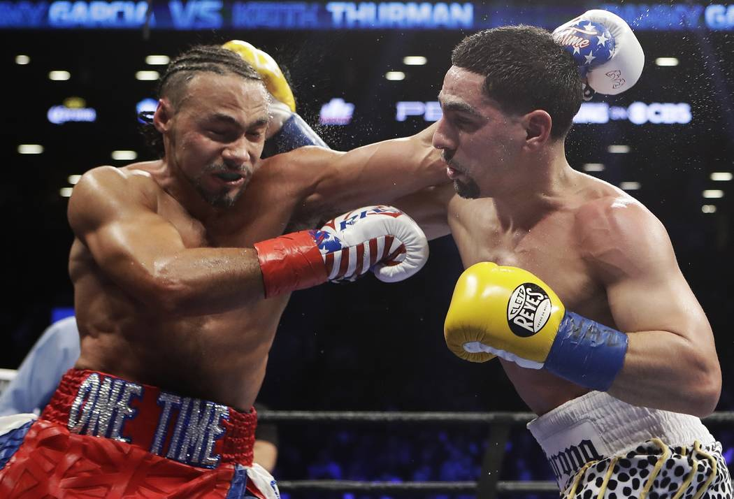 Keith Thurman, left, fights Danny Garcia during the fifth round of a welterweight championship boxing match Saturday, March 4, 2017, in New York. Thurman won the fight. (AP Photo/Frank Franklin II)