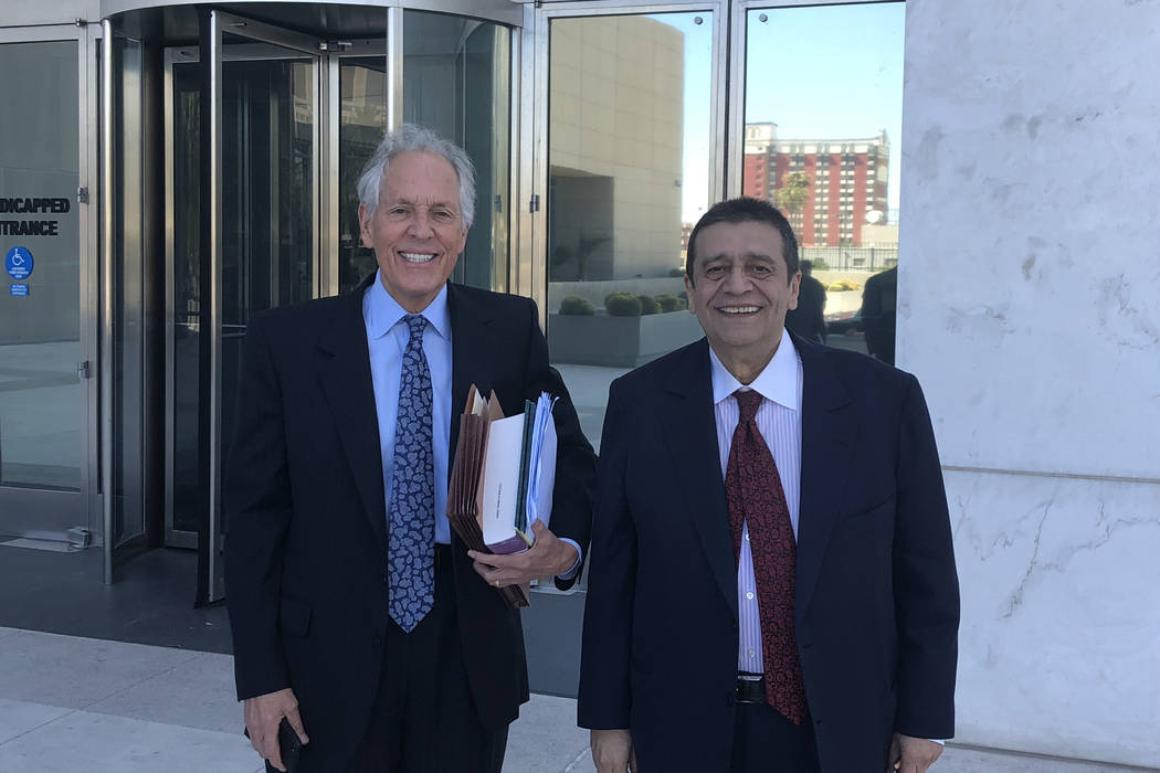 Las Vegas businessman Ramon DeSage, right, leaves the Lloyd George U.S. Courthouse with his attorney, Richard Wright, on Friday, Aug. 31, 2018, after pleading guilty to a charge of conspiracy to d ...