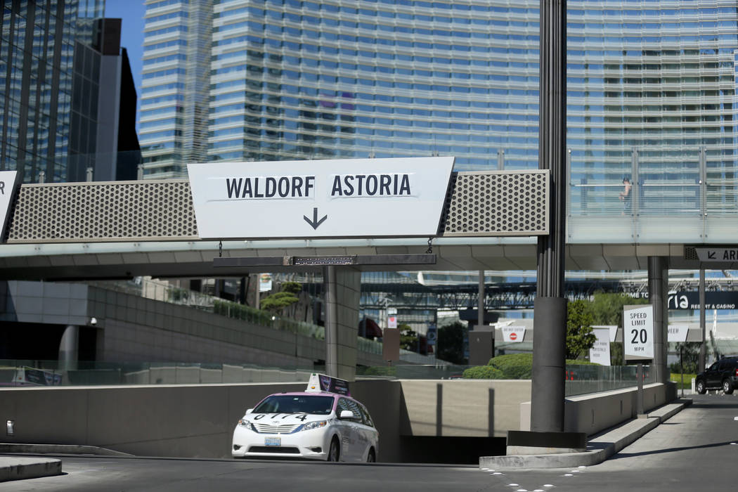 Temporary signs direct traffic to the Waldorf Astoria on the first day for the new Las Vegas hotel formerly known as Mandarin Oriental on the Strip Friday, Aug. 31, 2018. K.M. Cannon Las Vegas Rev ...