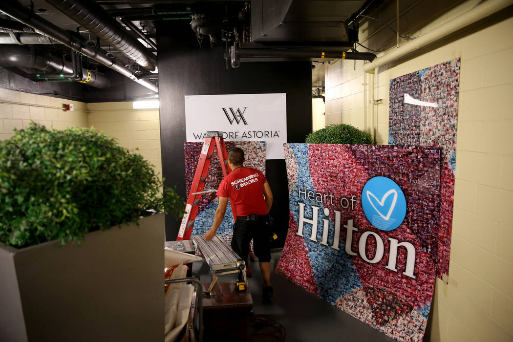 New signage in an employee area at the Waldorf Astoria on the first day for the new Las Vegas hotel formerly known as Mandarin Oriental on the Strip Friday, Aug. 31, 2018. Hilton Hotels started to ...