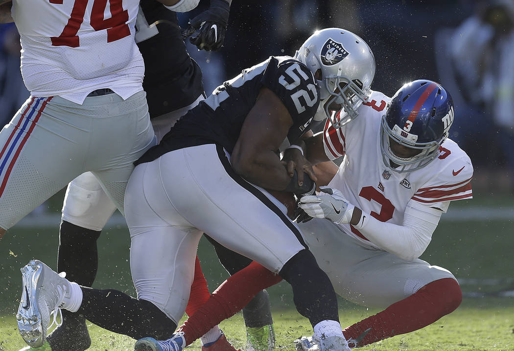efcc6582d Oakland Raiders defensive end Khalil Mack (52) sacks and forces a fumble  from New