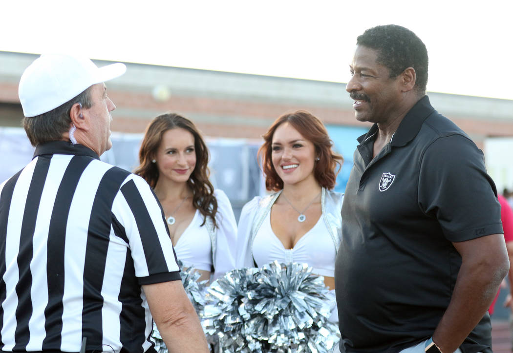 Former Oakland Raiders running back Napoleon McCallum, right, meets with the referee prior to the Foothill Falcons high school football game against Palo Verde in Henderson, Friday, Aug. 31, 2018. ...