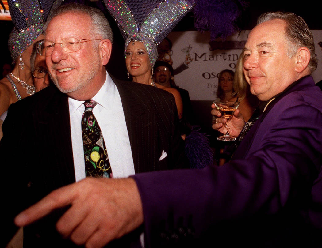 Robin Leach enjoys a martini with Mayor Oscar Goodman as the mayor shakes hands with celebrities and well-wishers in 2002. (Ralph Fountain/Las Vegas Review-Journal)