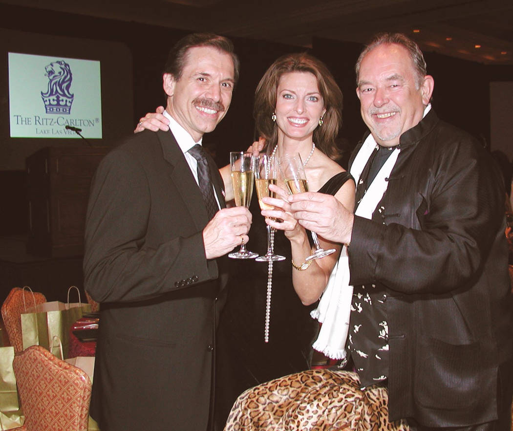 Michael Severino, left, Joan Severino and Robin Leach propose a toast at the Las Vegas Odyssey Food, Wine and the Art dinner in 2003.