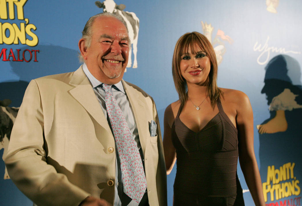 Robin Leach, left, arrives with Spike TV's Laura Diane on the red carpet for the opening night of Monty Python's Spamalot at Wynn Las Vegas March 31, 2007. (Sara Tramiel/Las Vegas Review-Journal)