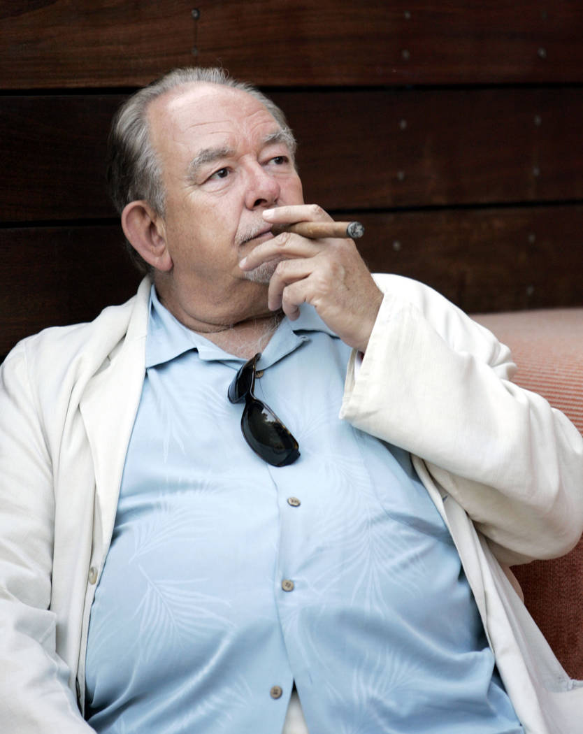 Television personality Robin Leach smokes a cigar while attending a party at Bare at Mirage Friday, April 27, 2007. (Ronda Churchill/Las Vegas Review-Journal)