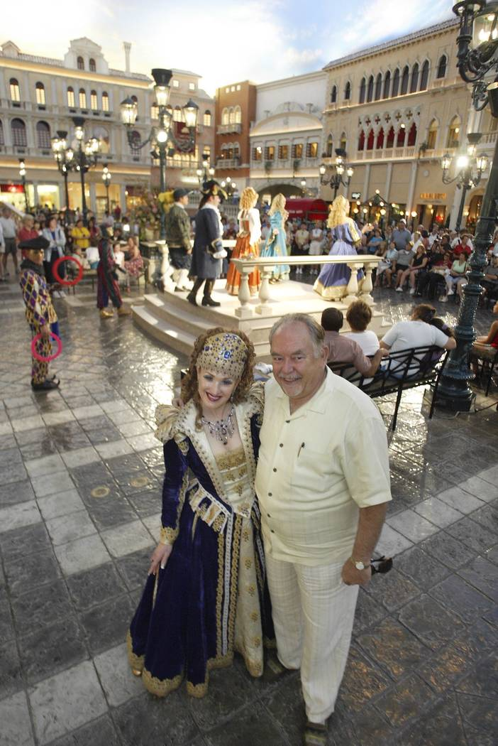"Robin Leach poses with Suzanne Farace, ""Duchess of Venis Donna Lucrezia,"" at St. Mark's Square inside The Venetian, July 22, 2004. (Clint Karlsen/Las Vegas Review-Journal)"
