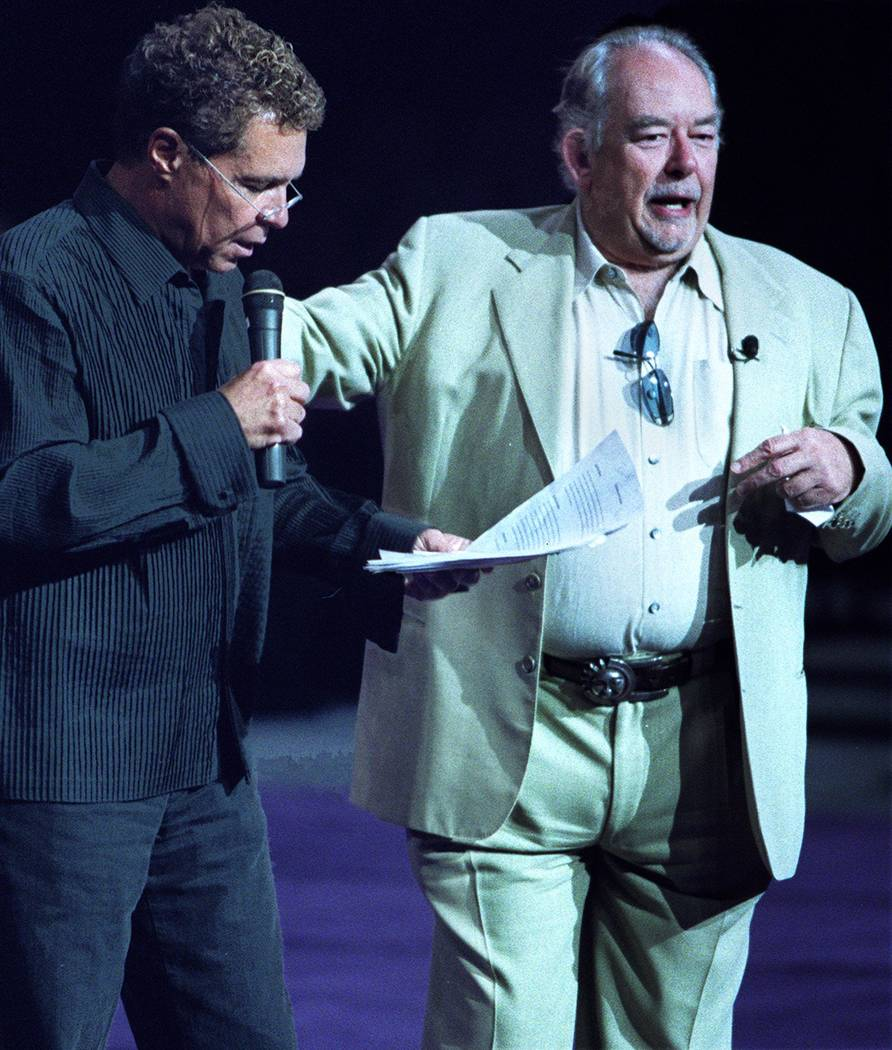 """Clint Holmes, left, hosts Animal Foundation's """"Best in Show."""" and Robin Leach served as celebrity judge.(Ralph Fountain/Las Vegas Review-Journal)"""