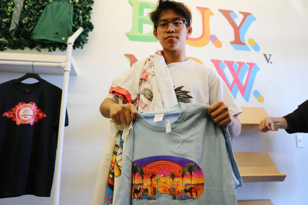 Reanu Elises holds up a Supreme shirt he bought at Fruition on South Maryland Parkway in Las Vegas, Saturday, April 28, 2018. The upscale streetwear store offers a monthly sale where shoppers can ...