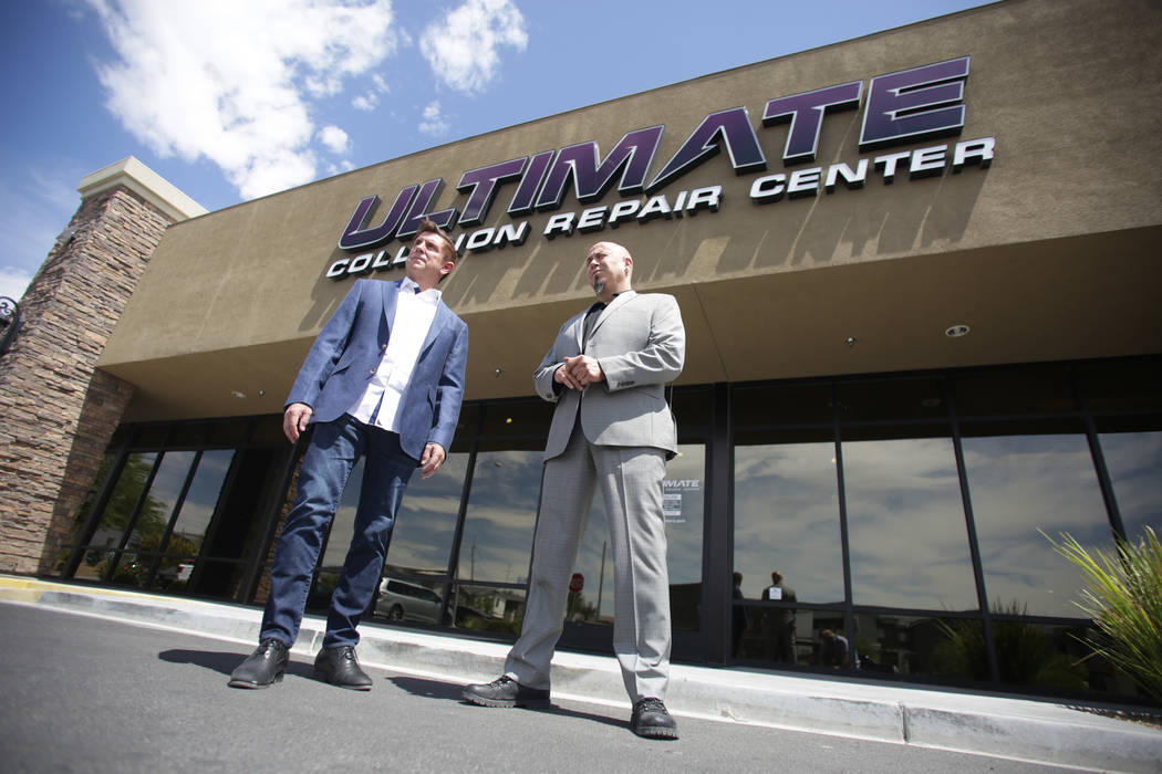 Ultimate Collision Repair Centers owner Brad Gothard, left, and manager Mario Watson stand in front of the company's Summerlin location on Friday, June 16, 2018. Michael Quine Las Vegas Rev ...