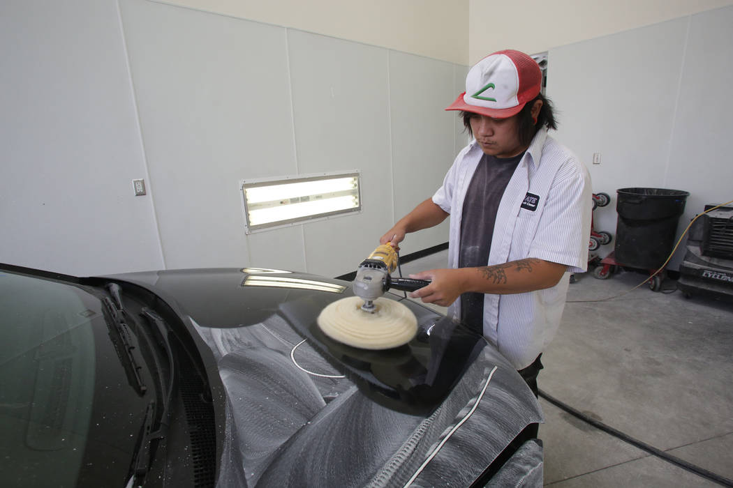 Tommy Ha of Ultimate Collision Repair Centers buffs out new paint as part of the finishing process at Ultimate Collision's Summerlin shop on Friday, June 16, 2018. Michael Quine Las Vegas R ...