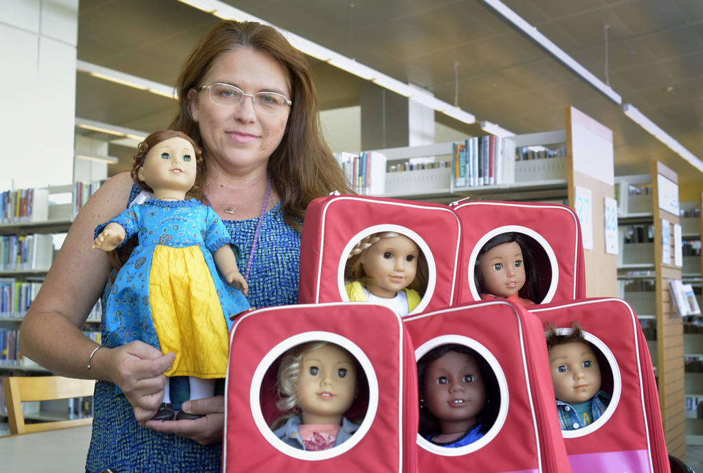 Rebecca Colbert, head of collection and bibliographic services for the Las Vegas-Clark County Library District, is shown with American Girl dolls at the Windmill Library at 7060 W. Windmill Lane i ...