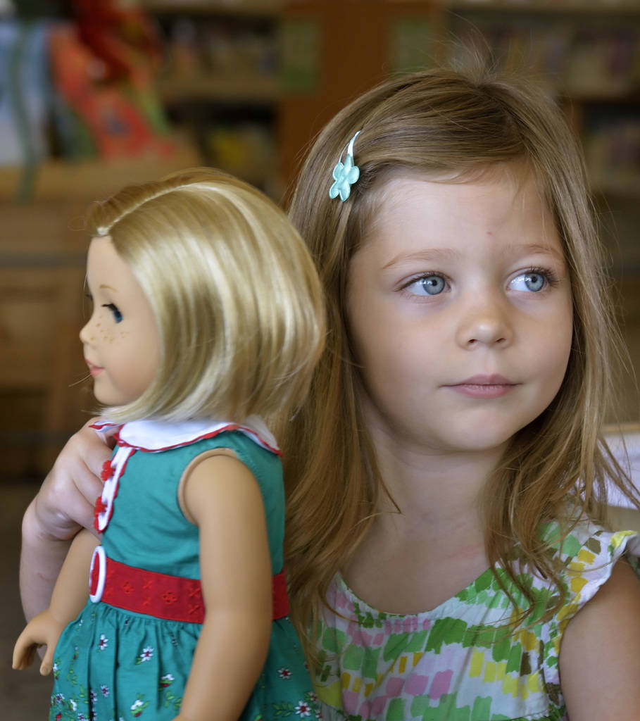Olivia Alt, 3, plays with an American Girl doll at the Windmill Library at 7060 W. Windmill Lane in Las Vegas on Thursday, July 26, 2018. The dolls are part of a toy lending program at the library ...