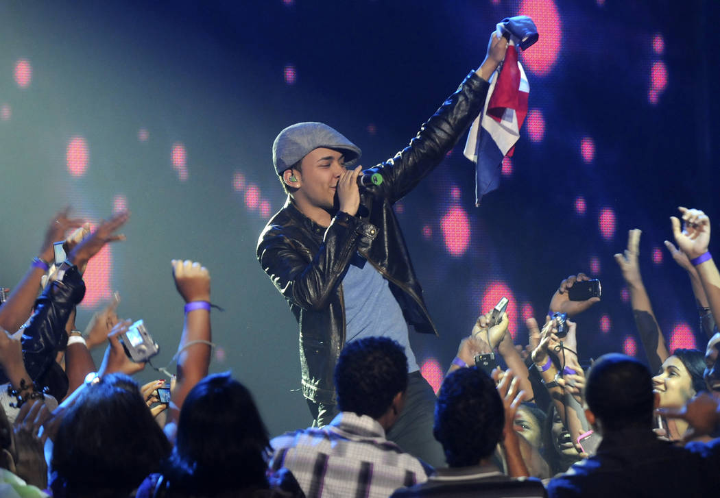 In this March 22, 2011, file photo, musician and record producer Prince Royce performs in Santo Domingo. Royce won 8 out of 10 categories in which he was nominated in the Youth Awards on Thursday, ...