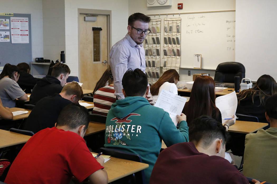 a06f5b4b59 Spencer Skees, Desert Oasis High School math teacher supervises his  student's test Thursday, Aug