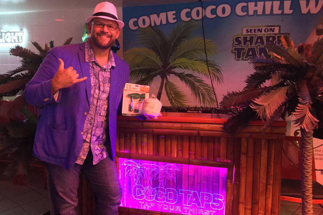 CocoVinny holds a Coco Taps toolkit and branded coconut at the Stratosphere on Aug. 7, 2018. (Bailey Schulz/Las Vegas Review-Journal)