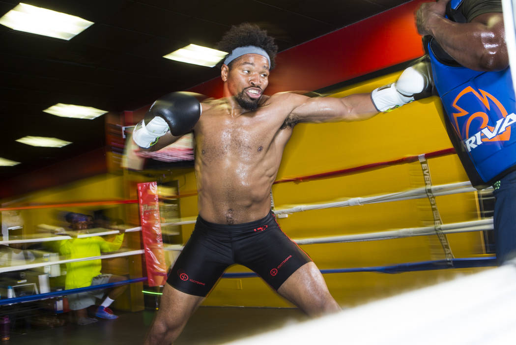 Boxer Shawn Porter, left, trains with his father Kenny at Porter Hy-Performance Center in Las Vegas on Wednesday, Aug. 15, 2018. Chase Stevens Las Vegas Review-Journal @csstevensphoto