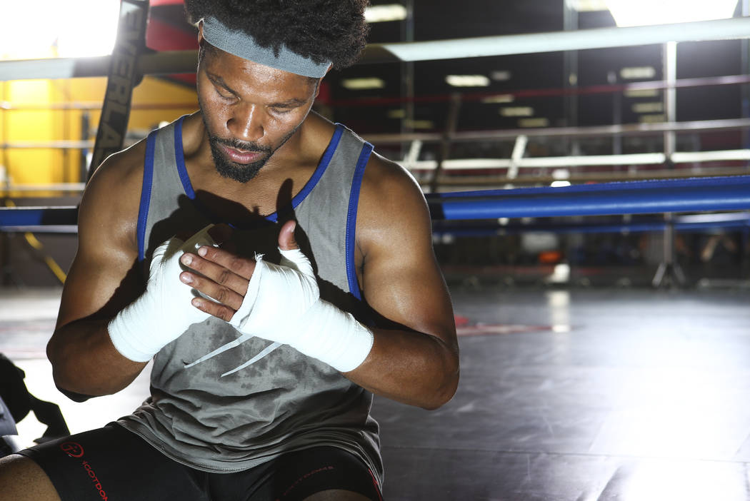 Boxer Shawn Porter wraps his hands before working out at Porter Hy-Performance Center in Las Vegas on Wednesday, Aug. 15, 2018. Chase Stevens Las Vegas Review-Journal @csstevensphoto