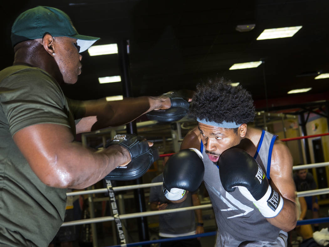 Boxer Shawn Porter, right, trains with his father Kenny at Porter Hy-Performance Center in Las Vegas on Wednesday, Aug. 15, 2018. Chase Stevens Las Vegas Review-Journal @csstevensphoto