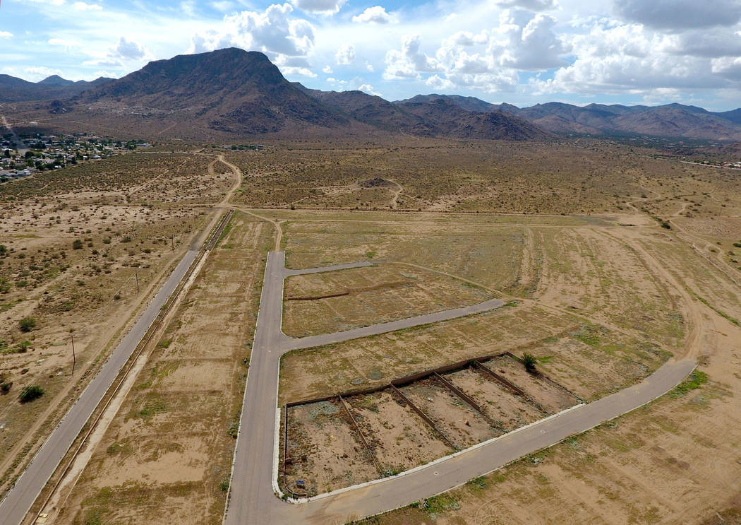 An a Aerial view of a subdivision off Win-Win Avenue in Kingman Ariz. lies abandoned but for damaged walls surrounding several lots with overgrown weeds on Friday, August 17, 2018. Michael Quine L ...