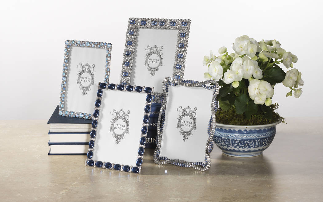 Olivia Riegel's set of blue frames are cast pewter in silver finish with hand-set clear European crystals banding, large cabochon sapphire faux gems or blue opaline glass gems. (Olivia Riegel)