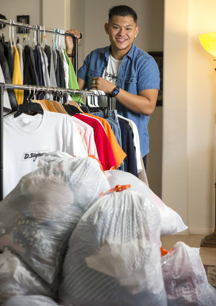 Eighteen-year-old Dylan Sanglay, who created his own clothing company and uses proceeds to buy clothes for the homeless, poses at his home in the Sunrise Manor area of Las Vegas on Sunday, Aug. 26 ...