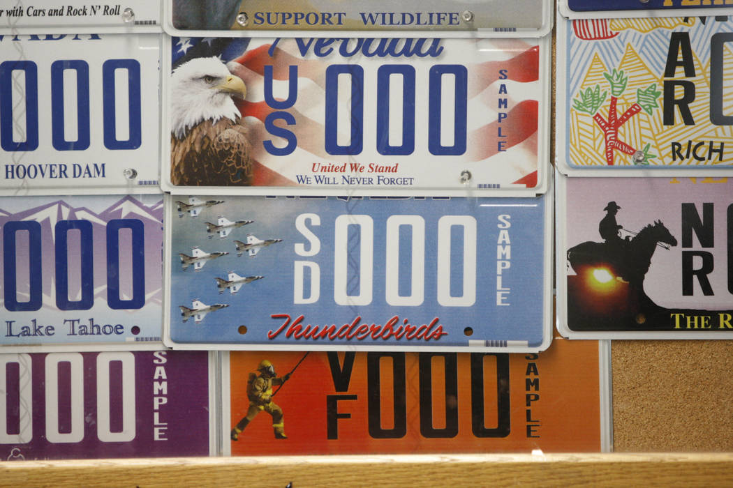 Specialty license plates decorate the wall at the DMV, 2701 E. Sahara Ave., in Las Vegas. (Erik Verduzco/Las Vegas Review-Journal)