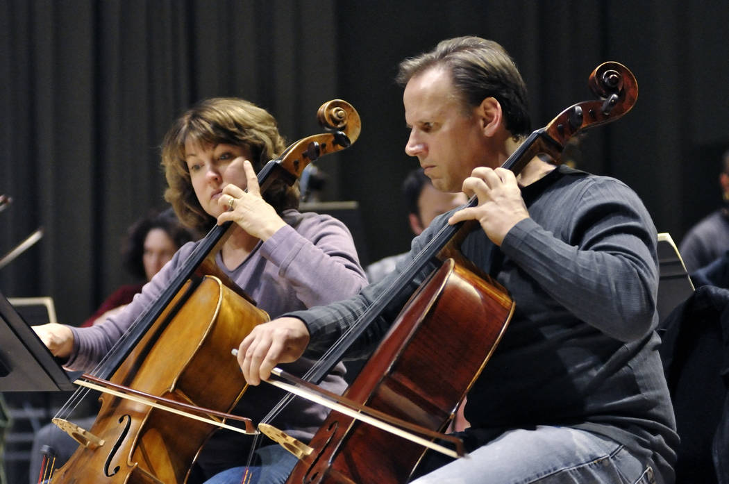 Cellists Robin Reinarz, left, and Andrew Smith play during a Las Vegas Philharmonic rehearsal in the Troesh Studio Theater at the Smith Center for the Performing Arts at 361 Symphony Park Ave., in ...
