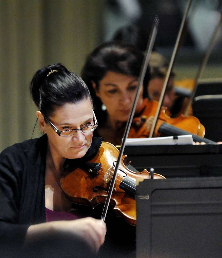 Concertmaster DeAnn Letourneau practices during a Las Vegas Philharmonic rehearsal in the Troesh Studio Theater at the Smith Center for the Performing Arts at 361 Symphony Park Ave., in Las Vegas, ...