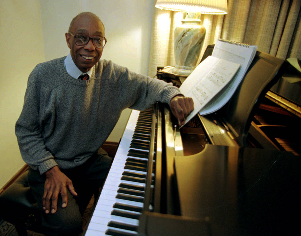 Composer George Walker, 73, winner of the 1996 Pulitzer Prize for music, poses at his piano in his home in Montclair, N.J., on Tuesday, April 9, 1996. Walker, a retired Rutgers University professo ...