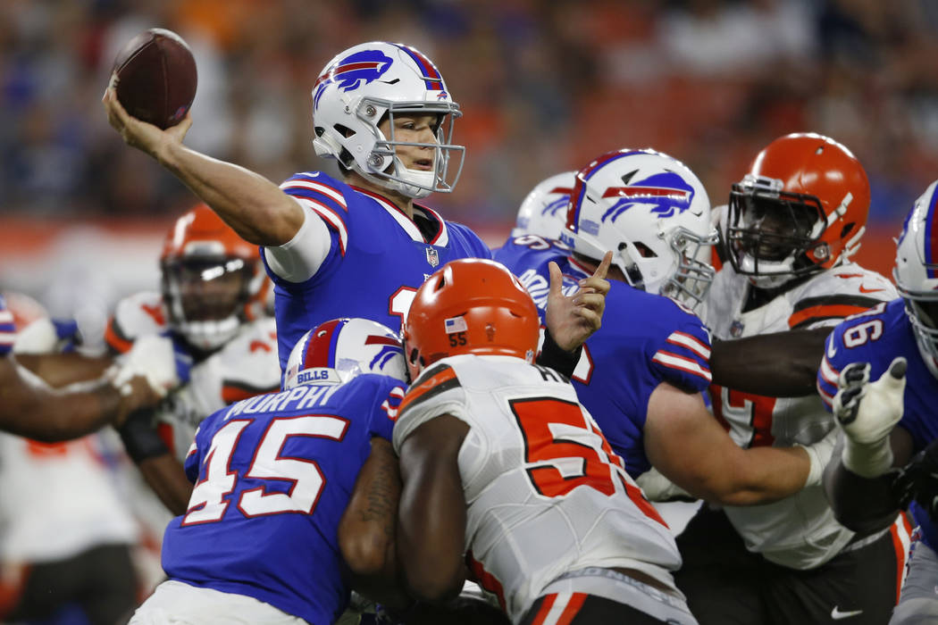 Buffalo Bills quarterback Josh Allen throws a pass during the first half of the team's NFL football preseason game against the Cleveland Browns in Cleveland, Friday, Aug. 17, 2018. (Ron Schwane/AP ...