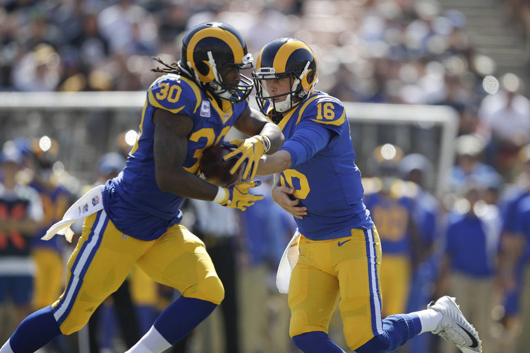 In this Sunday, Oct. 8, 2017, file photo, Los Angeles Rams quarterback Jared Goff (16) hands the ball to Todd Gurley (30) during an NFL football game against the Seattle Seahawks, in Los Angeles. ...