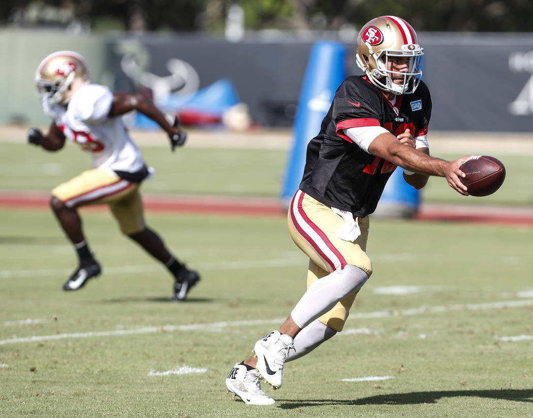 San Francisco 49ers quarterback Jimmy Garoppolo (10) reaches out for a handoff during a joint practice between the Texans and 49ers at the Methodist Training Center in Houston, Wednesday, Aug. 15, ...